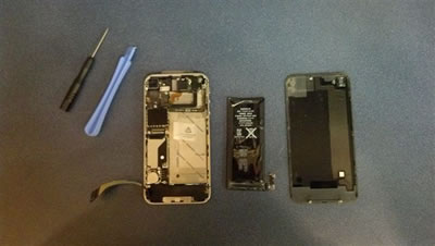 Phone opened for repair with tools